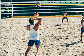 Beach volleyball game, serving