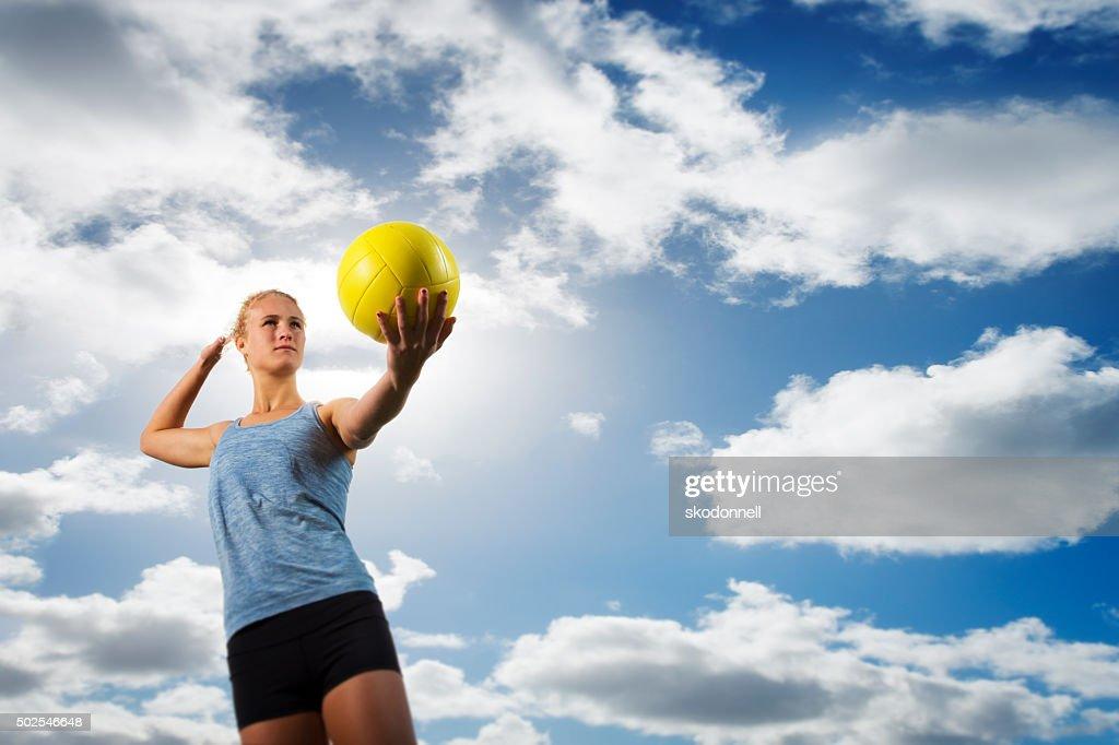 Beach Volleyball Girl Serving a Ball