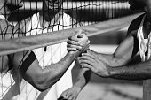 Beach volleyball players shaking hands after the match