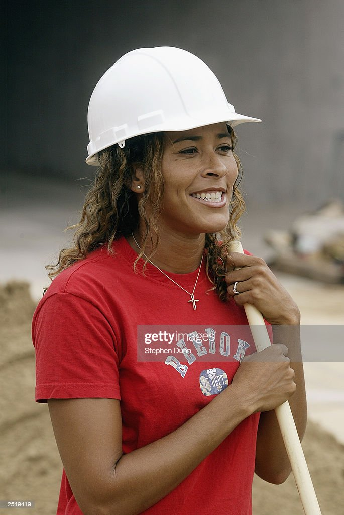 beach volleyball player jennifer dons a hardhat and holds a shovel on september