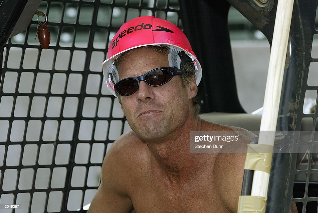 beach volleyball player karch kiraly wears a hard hat version of his trademark pink speedo cap