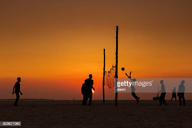 Beach volleyball silhouette on sunset