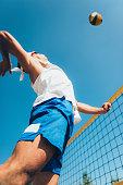 Beach volleyball spike shot, professional player