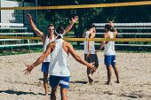 Beach volleyball team winning an important point
