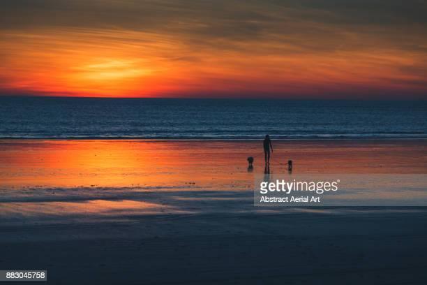 Beach walks at sunset