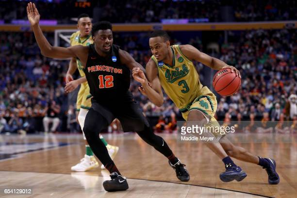 J Beachem of the Notre Dame Fighting Irish drives to the basket against Myles Stephens of the Princeton Tigers during the first round of the 2017...