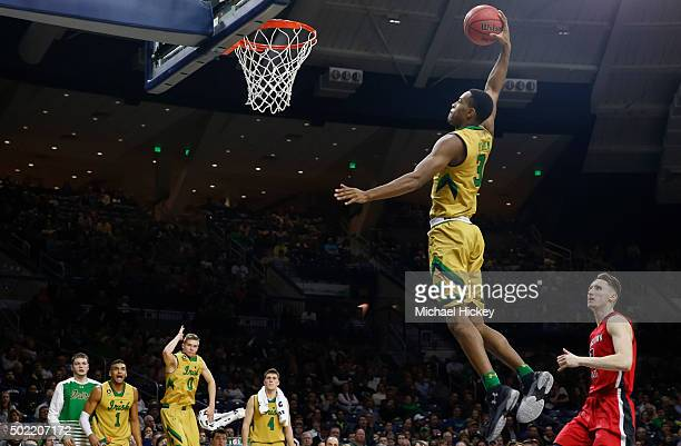 J Beachem of the Notre Dame Fighting Irish jumps through the air for a dunk against the Youngstown State Penguins at Purcell Pavilion on December 21...