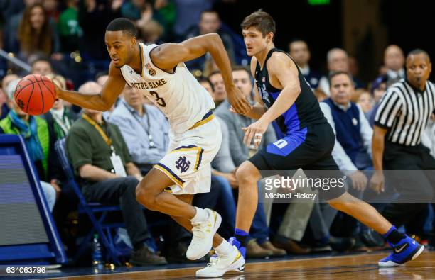 J Beachem of the Notre Dame Fighting Irish reaches for the ball against Grayson Allen of the Duke Blue Devils at Purcell Pavilion on January 30 2017...