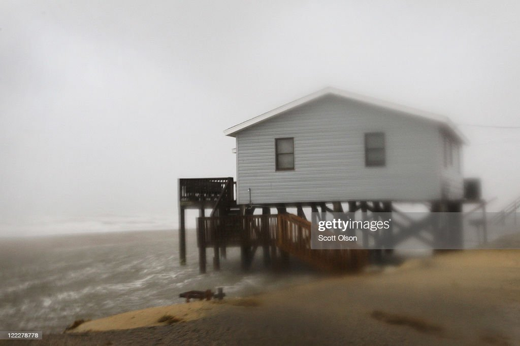 A beach-front cottage is pounded by wind and rain from Hurricane Irene August 27, 2011 in Nags Head, North Carolina. The eye of the hurricane is expected to hit Dare County, which sits along the Outer Banks and includes the vacation towns of Nags Head, Kitty Hawk and Kill Devil Hills, around mid-day.