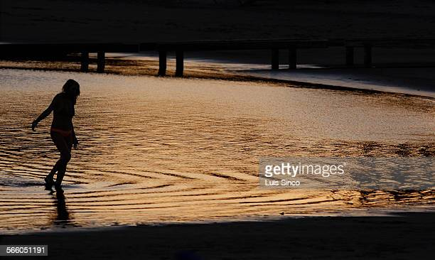 A beachgoer who declined to be identified wades into the waters of Mothers Beach in Marina Del Rey The Los Angeles County Flood Control District is...