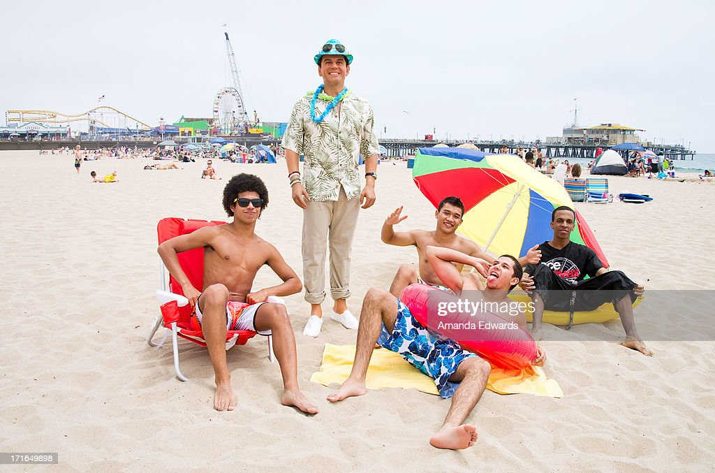 Beachgoers and a wax figure of outgoing Los Angeles Mayor Antonio Villaraigosa enjoy 'A Day At The Beach' compliments of Madame Tussauds Hollywood at Santa Monica Pier on June 26, 2013 in Santa Monica, California.