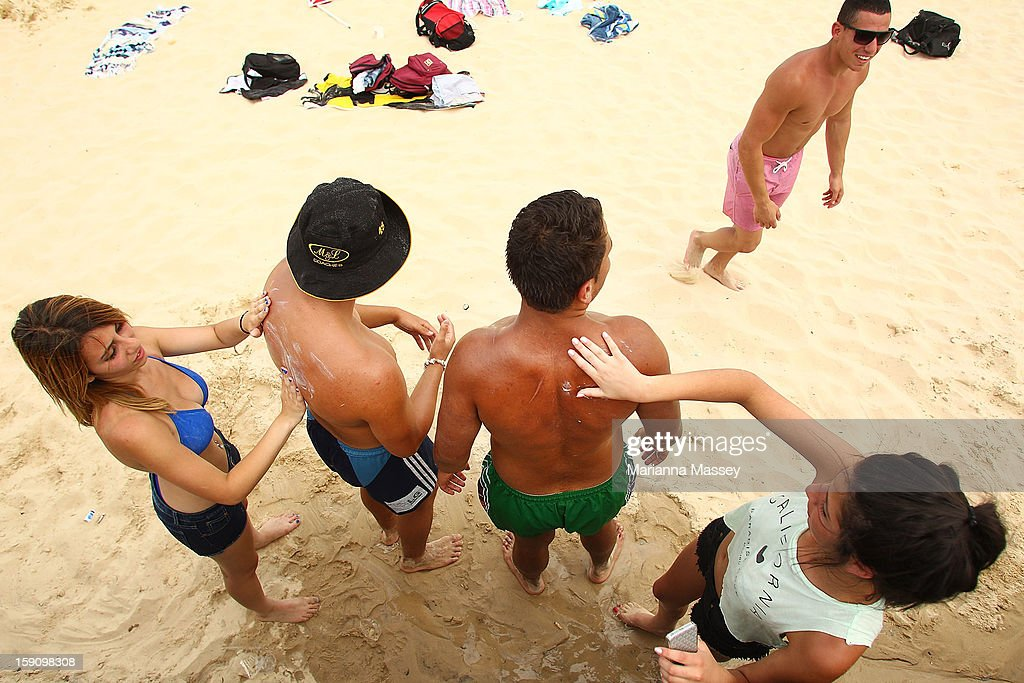 Beach-goers apply sunscreen to each other at Bondi Beach on January 8, 2013 in Sydney, Australia. Temperatures are expected to reach as high as 43 degrees around Sydney today.