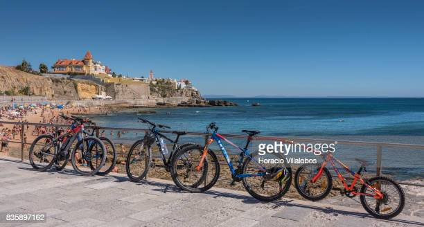 Beachgoers' bicycles seen by Praia da Poca on August 18 2017 in Estoril Portugal Record year for tourism 2016 figures for Portugal are being...