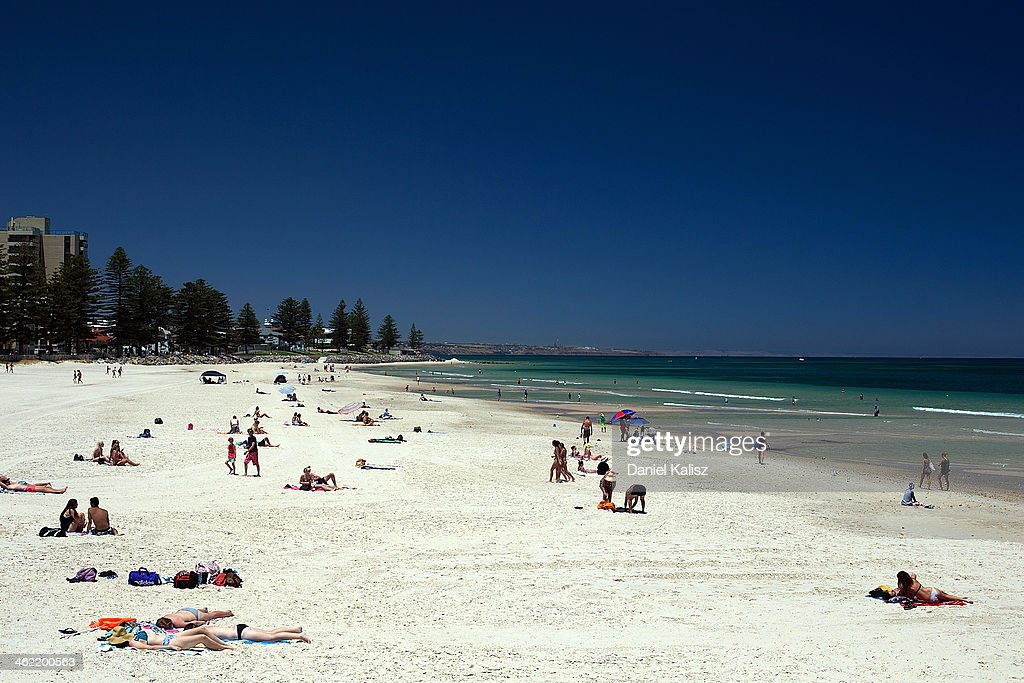 Beachgoers cool off during a heat wave at Glenelg beach on January 13, 2014 in Adelaide, Australia. Temperatures are expected to be over 40 degrees celsius all week with health authorities warning the young and elderly to remain indoors.