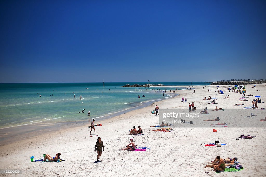 Beachgoers cool off from the heat during a heat wave at Glenelg beach on January 13, 2014 in Adelaide, Australia. Temperatures are expected to be over 40 degrees celsius all week with health authorities warning the young and elderly to remain indoors.