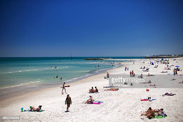 Beachgoers cool off from the heat during a heat wave at Glenelg beach on January 13 2014 in Adelaide Australia Temperatures are expected to be over...