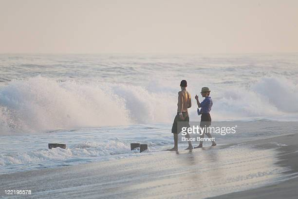 Beachgoers enjoy the huge waves prior to the arrival of Hurricane Irene on August 26 2011 in Southampton New York