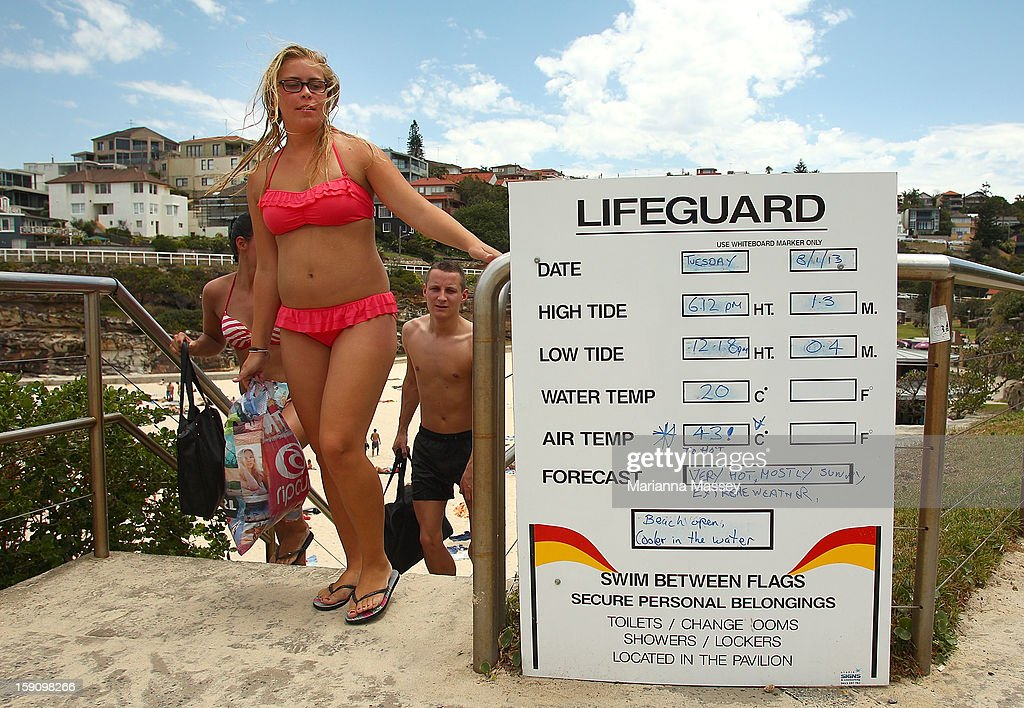 Beach-goers leave Tamarama Beach after cooling off in the water where a lifeguard sign warns of the dangerous heat conditions on January 8, 2013 in Sydney, Australia. Temperatures are expected to reach as high as 43 degrees around Sydney today.
