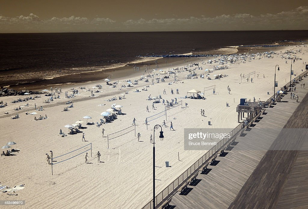 Beachgoers populate the beach on August 9 2014 in Long Beach New York