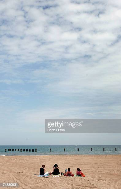 Beachgoers relax on North Avenue beach May 25 2007 in Chicago Illinois Although beaches in the city officially opened today cool weather kept the...