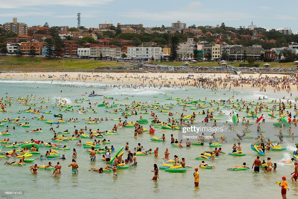 Beachgoers ride inflatable thongs at Bondi beach as part of the 2013 Australia Day Celebrations on January 26, 2013 in Sydney, Australia. Australia Day, formerly known as Foundation Day, is the official national day of Australia and is celebrated annually on January 26 to commemorate the arrival of the First Fleet to Sydney in 1788.