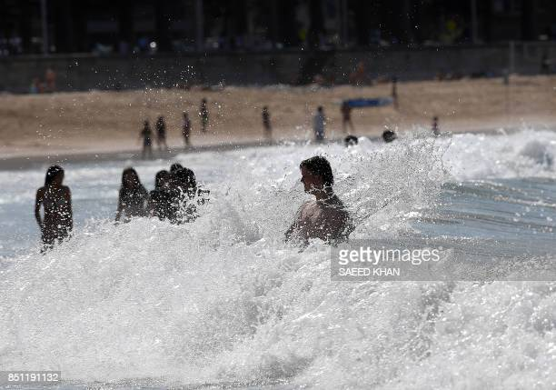 Beachgoers spend their afternoon at Manly Beach in Sydney on September 22 2017 Sydney and other parts of New South Wales expected to recieve a heat...