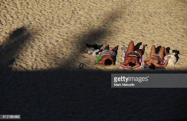 Beachgoers sunbathe at Coogee on February 25 2016 in Sydney Australia The bureau of meteorology forecast temperatures over 40 degrees for parts of...