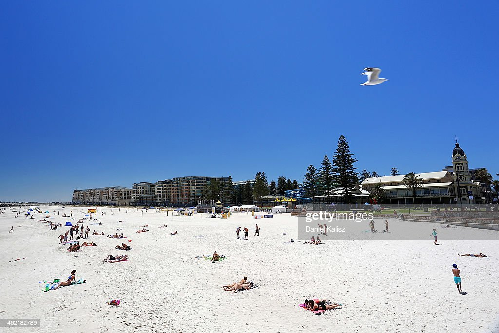 Beachgoers sunbathe on the popular Glenelg beach during a heat wave at Glenelg on January 13, 2014 in Adelaide, Australia. Temperatures are expected to be over 40 degrees celsius all week with health authorities warning the young and elderly to remain indoors.