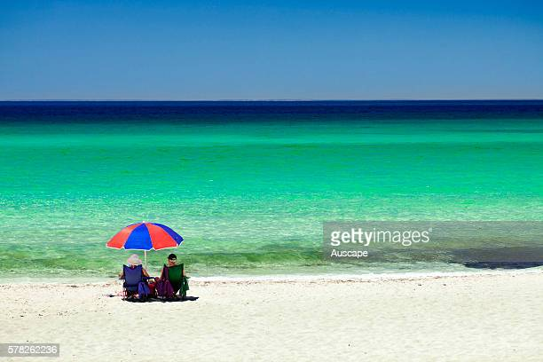 Beachgoers under umbrella and the crystal clear water of Geographe Bay Dunsborough Western Australia Australia