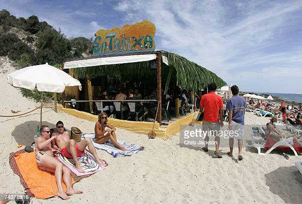 Beachgoes relax in front of Sa Trinxa bar on Salinas Beach on June 1 2007 in Ibiza Spain Ibiza remains one of the world's top holiday destinations...