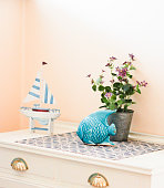 Hall Table decorated with some nautical and marine style objects. A place for keys near the front door.
