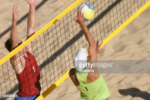 Beachvolley two players duel at the net
