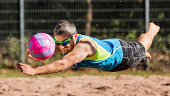 Beachvolleyballer hitting a ball