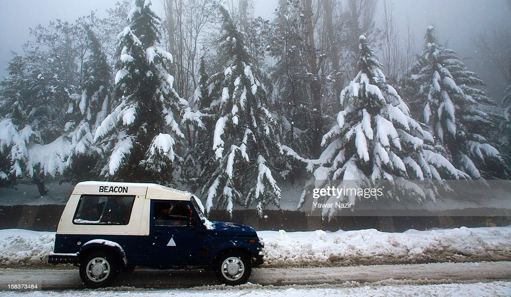 A beacon officer inspects the highway in his vehicle amid heavy snowfall on December 14, 2012, in Banihal, 110 km (68 miles) south of Srinagar, the summer capital of Indian Administered Kashmir, India. Most parts of the Kashmir Valley, including Srinagar, received fresh snowfall, leading to closure of the 300 km (188 miles) Jammu-Srinagar Highway, the only road link between Kashmir and rest of India. Project Beacon authorities of the Border Roads Organisation, that maintains the highway, had already started efforts to clear the highway for traffic. The number of vehicles stranded on the highway was being ascertained.