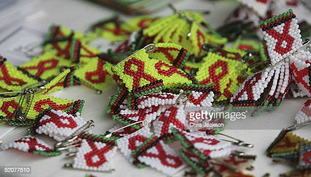 Bead badges displaying the Red AIDs support emblem are seen as HRH Crown Princess MetteMarit of Norway visits NAPHAM on January 27 2005 in Lilongwe...