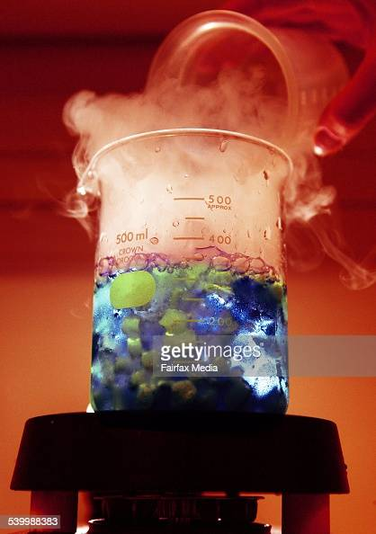 A beaker with blue and green liquid and dry ice from experiments conducted by laboratory students at the Australian National University Canberra 17...