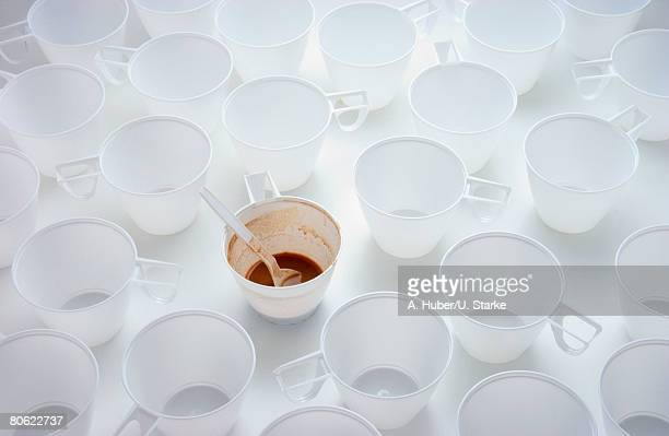 Beakers, one filled with coffee