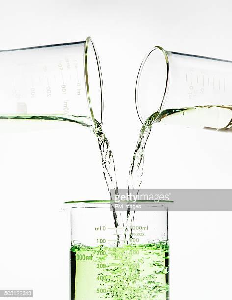 Beakers Pouring Liquid Larger Beaker