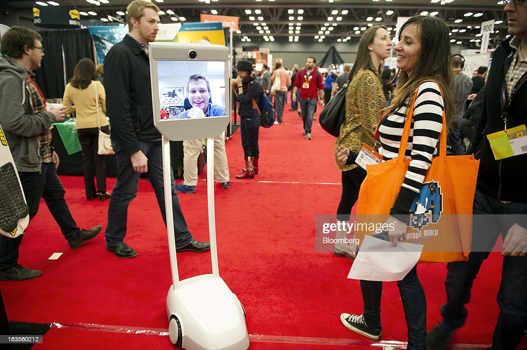 Beam, a remote presence system made by Suitable Technologies, wanders the floor at the South By Southwest Conference (SXSW) in Austin, Texas, U.S., on Monday, March 11, 2013. The 20th annual SXSW Interactive Festival takes place March 8-12. Photographer: David Paul Morris/Bloomberg via Getty Images