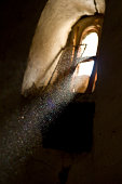 Beam of light in dusty environment