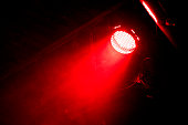 Red beam of light in the dark. There is some steel frame seen in back. Shot on a rock concert.