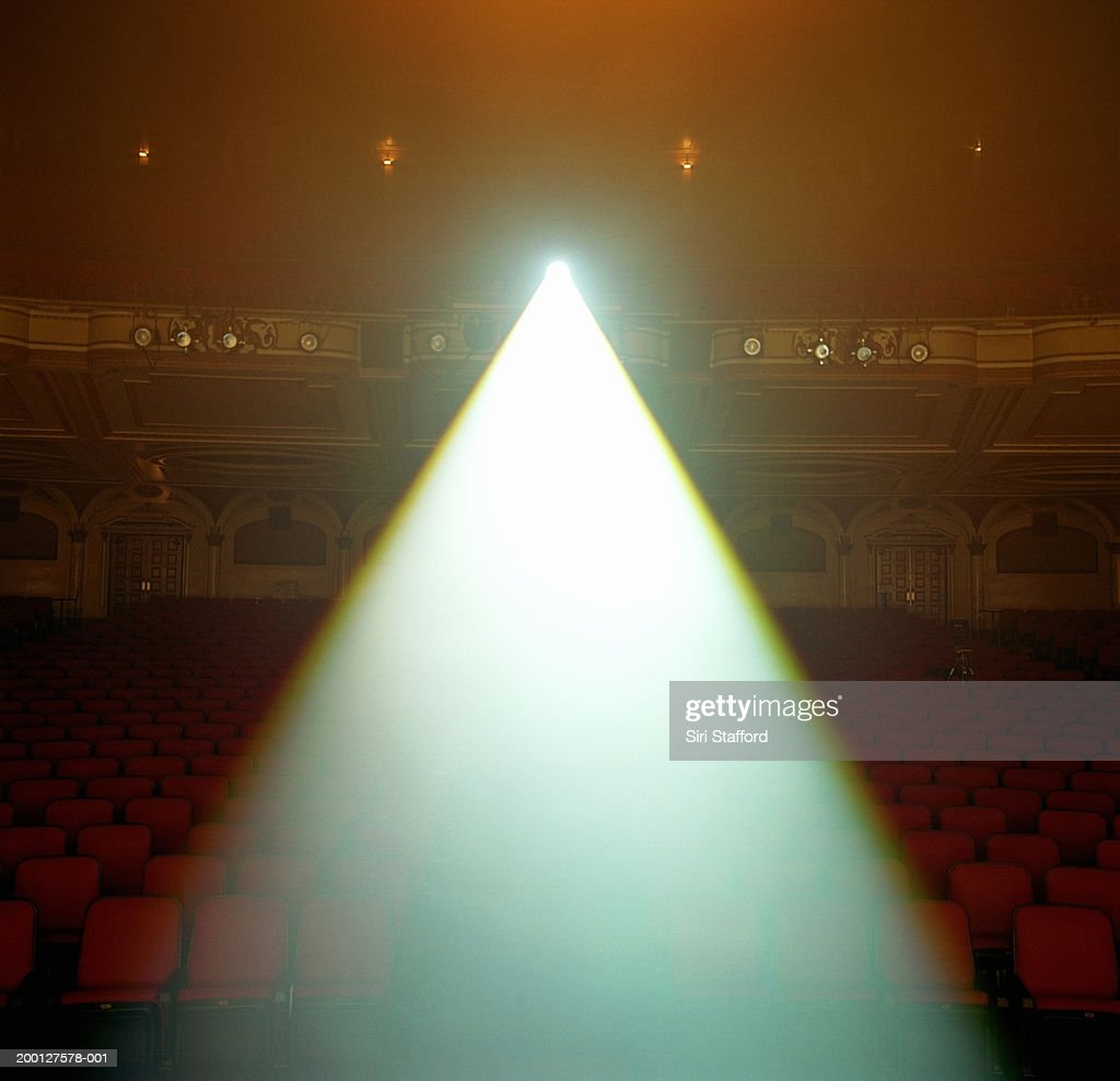 Beam of spotlight projected in theater : Stock Photo