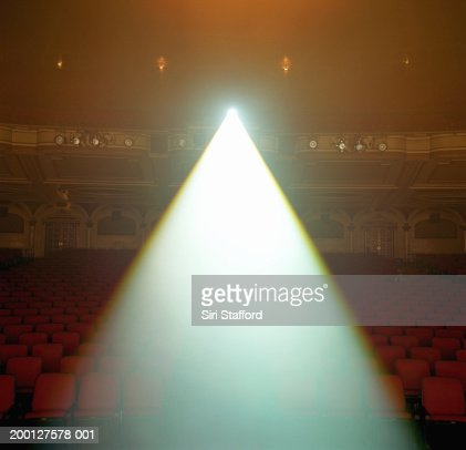 Beam of spotlight projected in theater