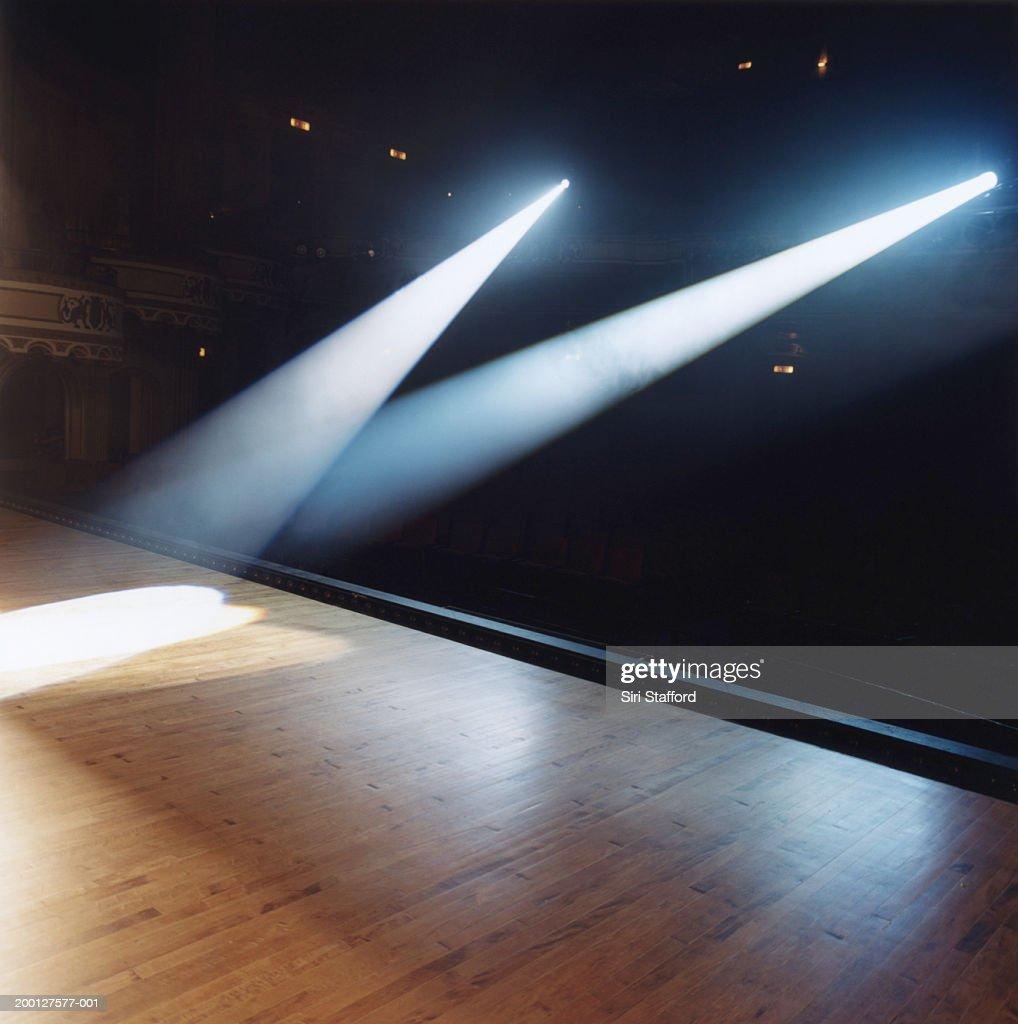 Beams of spotlights shining on stage floor : Stock Photo