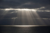 Beams of sunlight over water