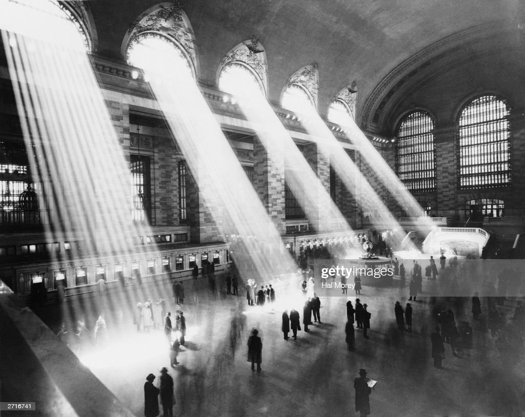 Beams of sunlight streaming through the windows at Grand Central Station New York City circa 1930