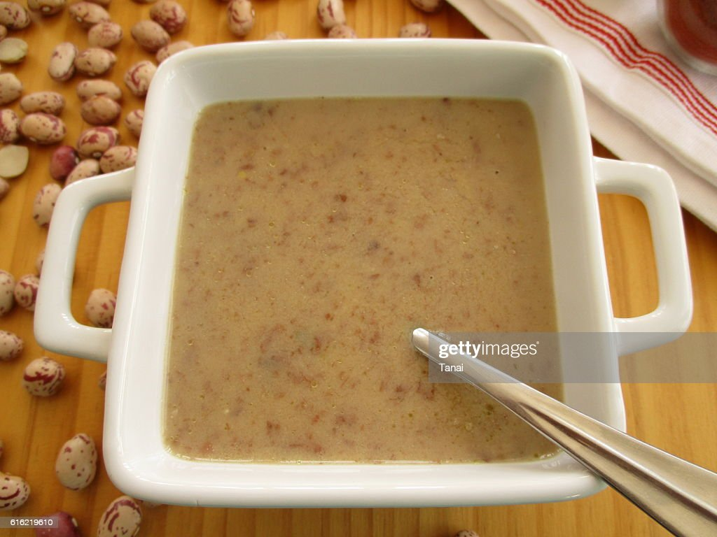 Bean soup in square bowl with spoon : Stock Photo