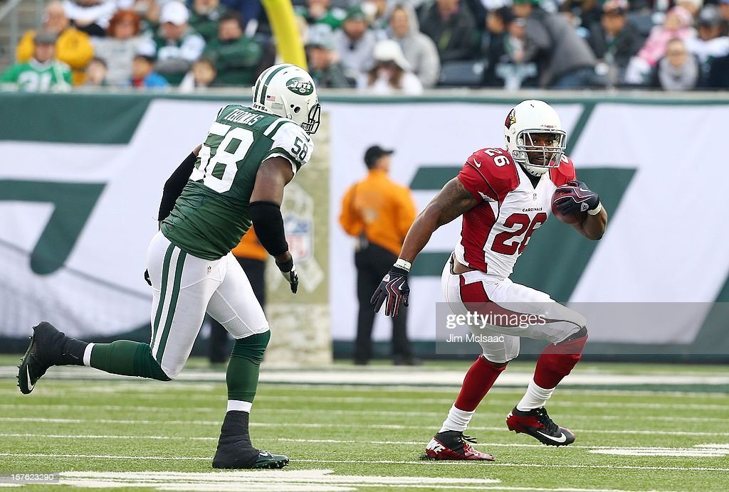 Beanie Wells of the Arizona Cardinals in action against Bryan Thomas of the New York Jets at MetLife Stadium on December 2 2012 in East Rutherford...