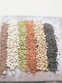 Beans and Lentils Arranged in Lines on a Chopping Board