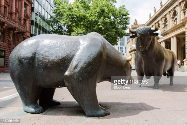 A bear and a bull statue stand outside the Frankfurt Stock Exchange in Frankfurt Germany on Wednesday July 30 2014 The US is considering further...